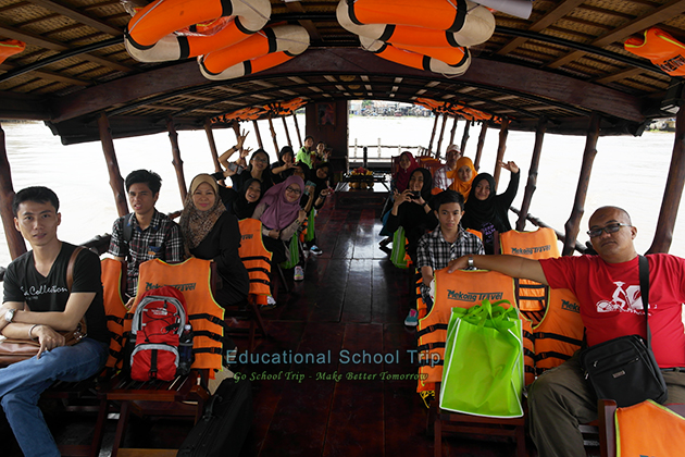 Student and teacher in a boat to discover Mekong Delta