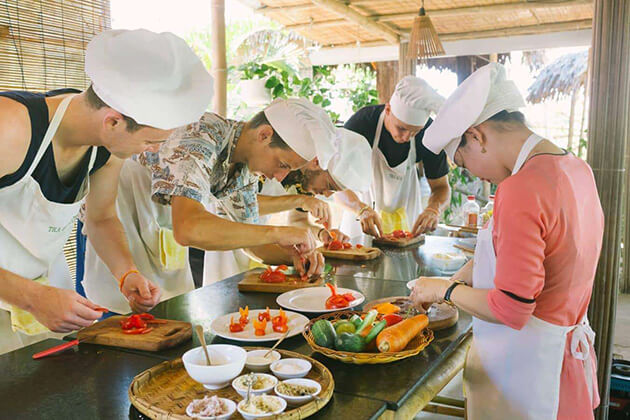 Cooking class at Red Bridge in Vietnam student tour