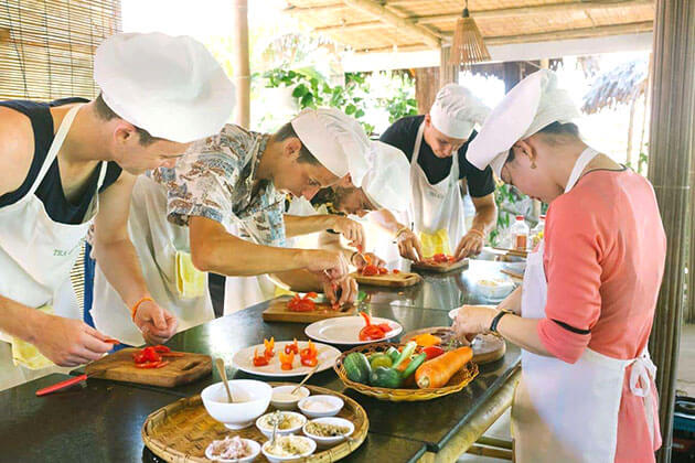 students in Vietnam school tour join Red Bridge Cooking Class in Hoi An