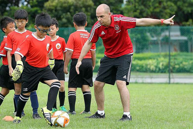 Student Join Football Match in Guangzhou