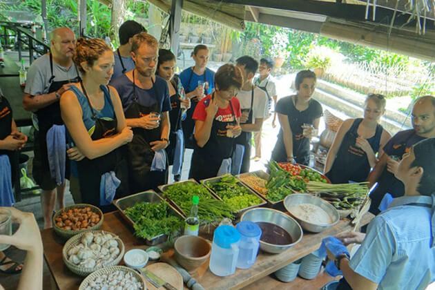 Students join cooking class in Laos