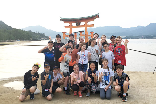Students visit Itsukushima Shrine Japan