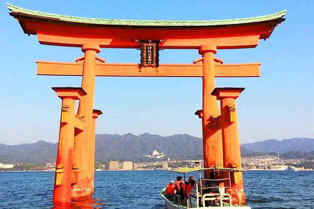 Students visit Itsukushima Shrine in Japan