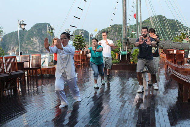 Tai Chi exercises in morning Halong cruise