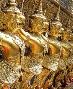 golden statues at grand palace in bangkok