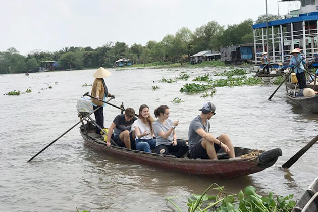 students boat around Mekong Delta from Vietnam school trip