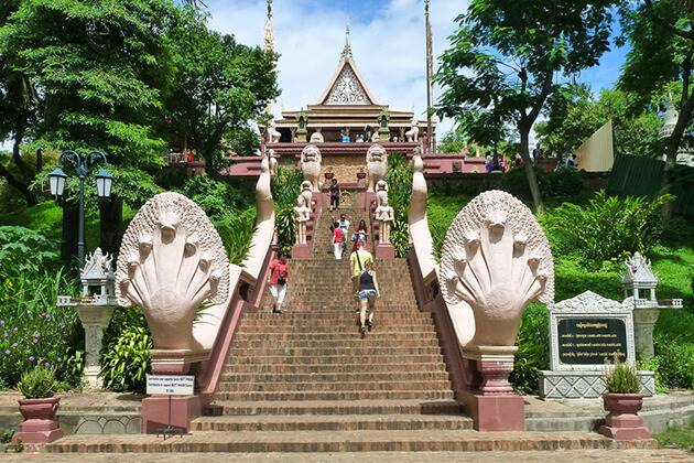 students of Cambodia school tours visit Wat Phnom Temple
